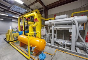 A compressor room, where the landfill gas is cleaned up and prepared before traveling to the engine.