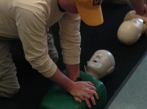 An Energy Services operations technician practices his CPR training.